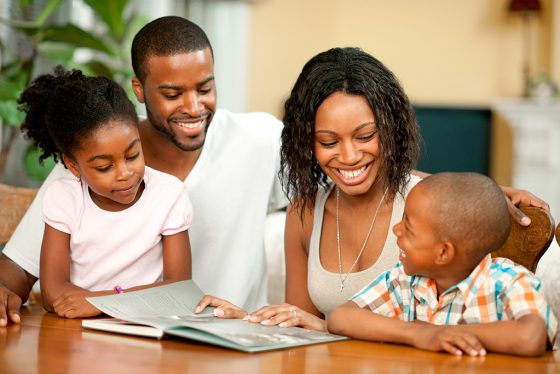 african-american-family-reading-together-ages6-7